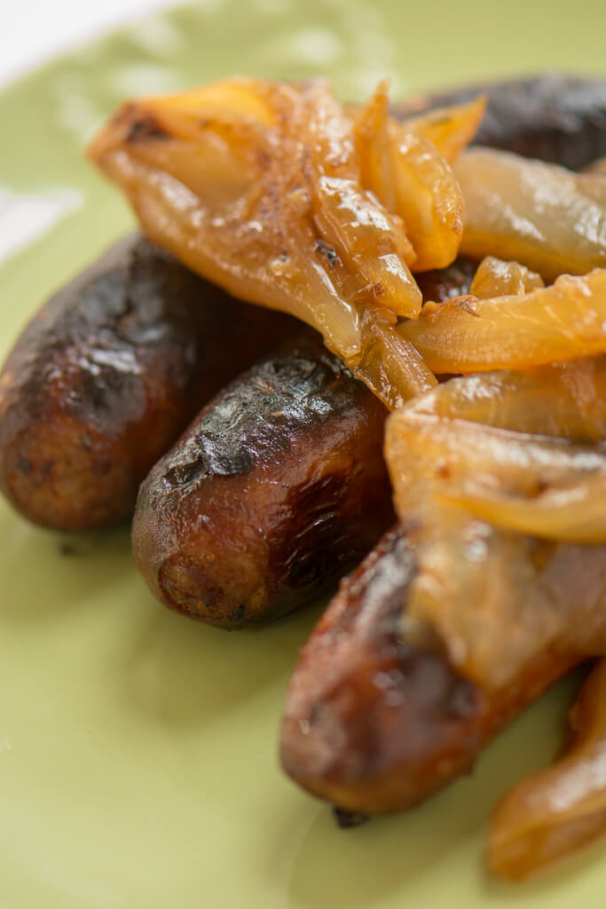 Grilled Beer Brats with Sautéed Onions