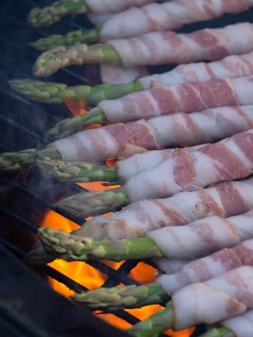 Bacon Wrapped Asparagus Yakitori over flames on Big Green Egg