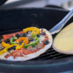 Grilled Pizza on the Big Green Egg - Adding the pizza to the hot grill