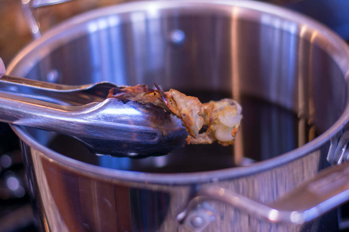 Adding Chicken Bones to Liquid on the Stove Top
