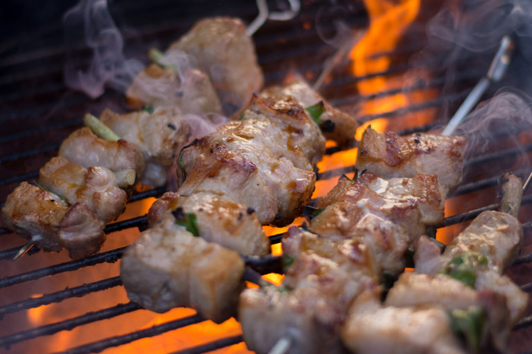 Steam Coming off Pork Belly Skewers - On the Big Green Egg
