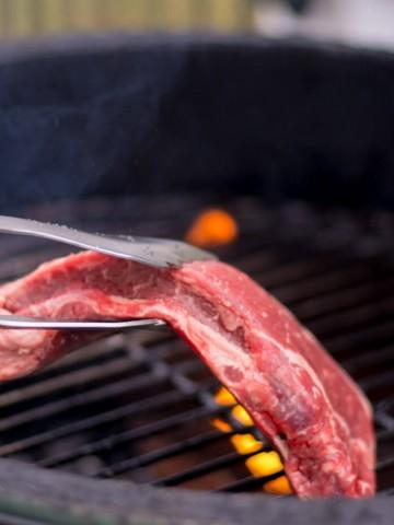 Adding the Strip Steak to the Big Green Egg