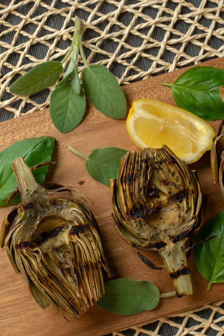Artichokes with Sear Marks on a Cutting Board