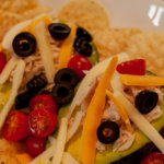 Grilled Chicken Stuffed Avocado with Black Olives and Cheese