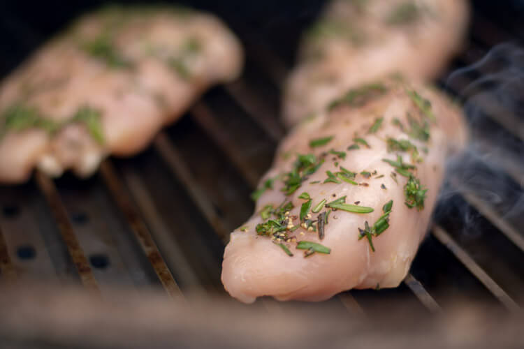 Grilled Rosemary Thyme Chicken Breasts Fresh on the Hot Grill with GrillGrates