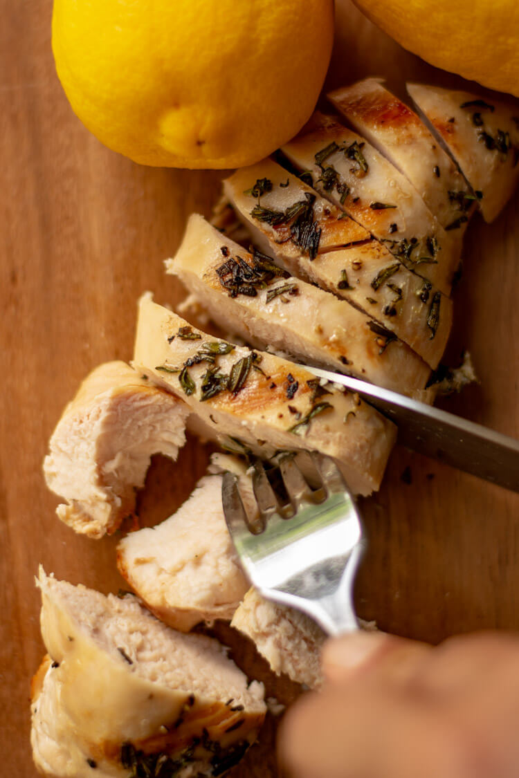 Grilled Rosemary Thyme Chicken Breast Sliced on the Cutting Board