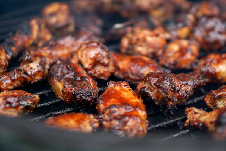 Smoked DizzyPig IPA Dry Rub Chicken Wings Ready to be Removed from Big Green Egg