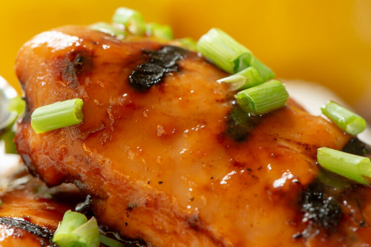 Closeup of the Green Onions on the Sweet and Spicy BBQ Chicken Recipe