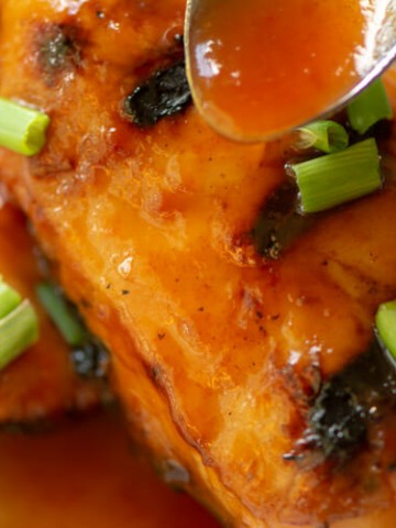 Sweet and Spicy BBQ Sauce Dripping Down the Boneless Skinless Chicken Breast