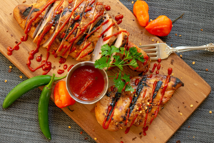 Sriracha Sauce Drizzled over Grilled Honey Sriracha Chicken Breasts