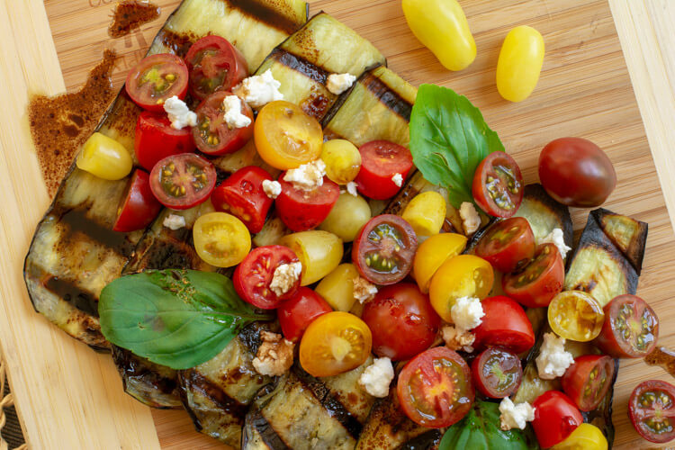 Grilled Eggplant Goat Cheese and Tomato Salad with a balsamic vinaigrette