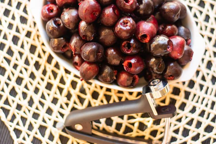 Pitting Cherries for the Cherry Bourbon BBQ Sauce
