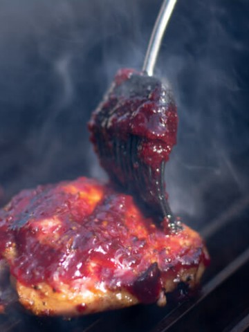Thickly applied Cherry Glaze to the Chicken on the Big Green Egg