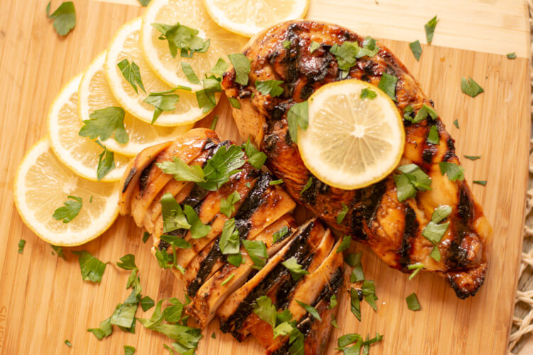 Grilled Honey Lemon Chicken Sliced and topped with fresh lemon slices.