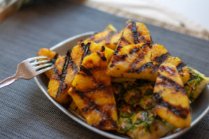 Grilled Cinnamon Pineapple on a bed of the pineapple skin