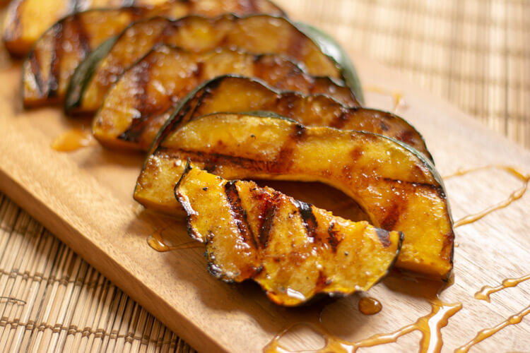 Drizzled Honey over the fully cooked acorn squash on the cutting board