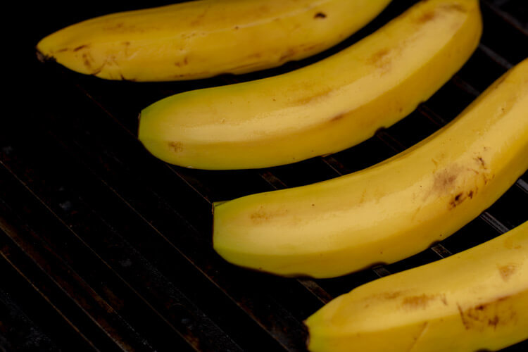 Start by placing the bananas, cut side down, on the grill