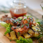 Grilled Huli Huli Chicken Sitting on Fresh Grilled Pineapple