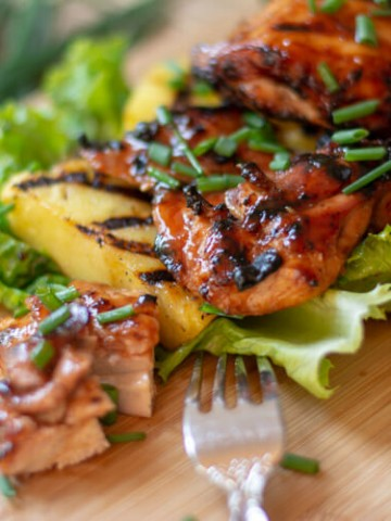 Grilled Huli Huli Chicken Resting on Grilled Pineapple Slices