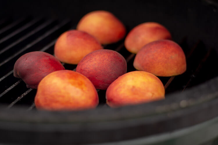 Placing the Grilled Peaches Face Down on the Big Green Egg