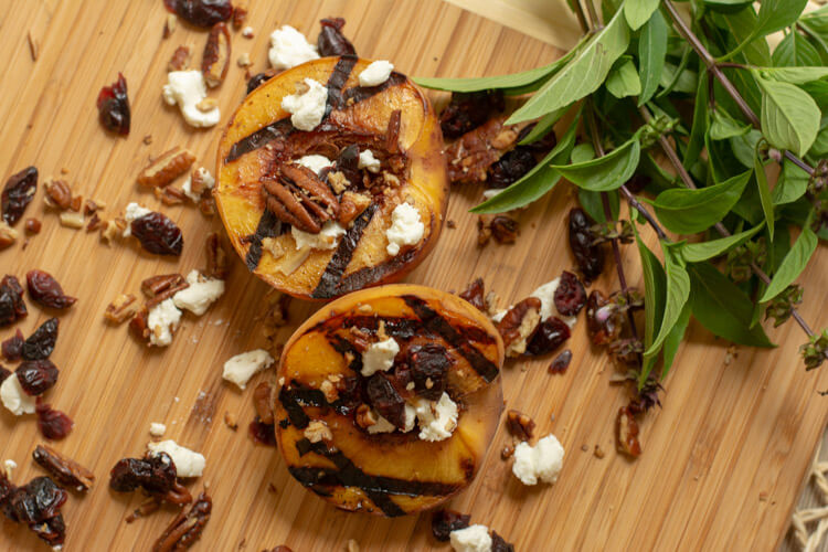 Grilled Peaches with Goat Cheese Pecans and Dried Cranberries