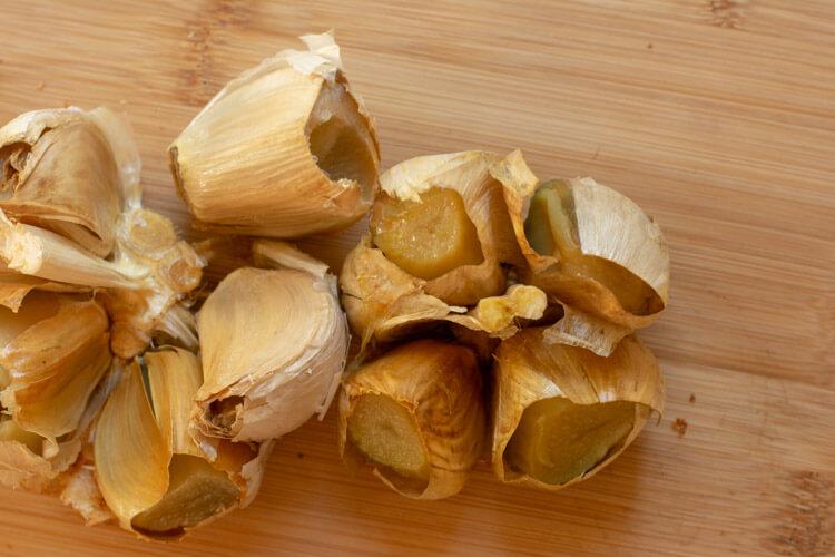 Grilled Roasted Garlic on a Cutting Board