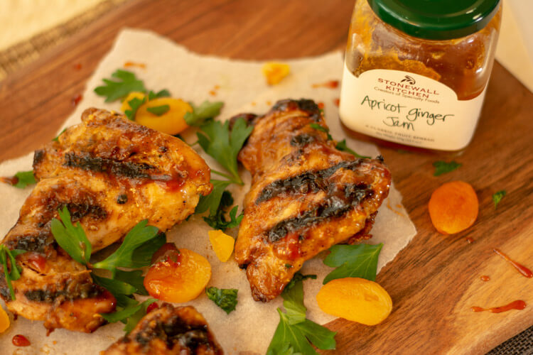 Chicken Thighs with an Apricot Ginger BBQ sauce on a cutting board