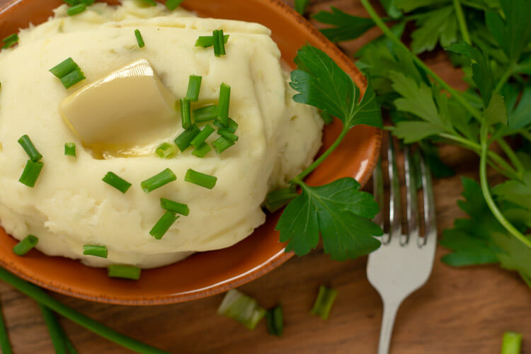 Melted Butter on the Roasted Garlic Mashed Potatoes with Cream Cheese