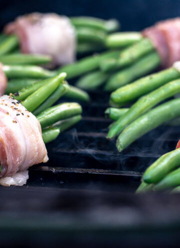 Freshly Wrapped Green Bean Bundles on the GrillGrate on the Big Green Egg with a little bit of Smoke Rising