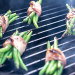Nearly Finished Bacon Wrapped Green Beans on the BGE. The Asian Sauce is Creating a bit of Smoke