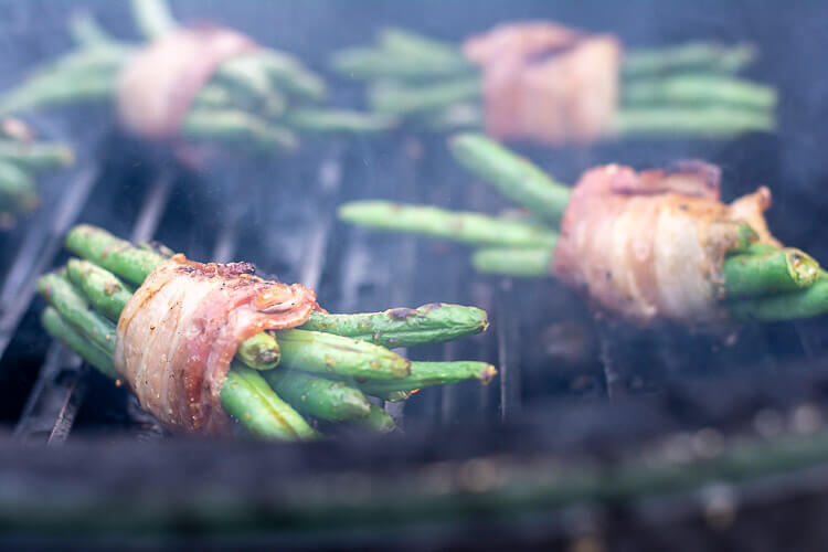 Closeup of the Big Green Egg and Grill Grate with the Bundle of Green Beans. The Asian Sauce is Brushed on the Bundle