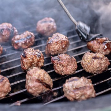 Brushing on the Sauce on Meatballs. The Grill Marks are Working Nicely on the meat.