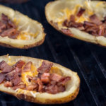 Cheese and Bacon Bits are Bubbling on the Potato Skins on the Big Green Egg