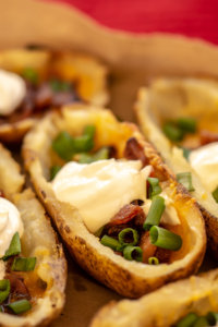 Front picture of Loaded Grilled Potato Skins Recipe with Sour Cream, Green Onions and Bacon Bits