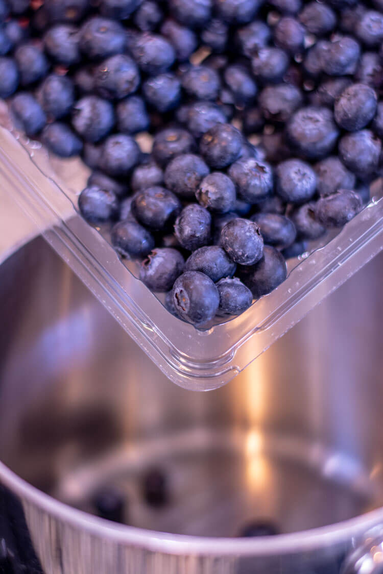 nice fresh blueberries to start the sauce. They are being added to the pan on the stovetop
