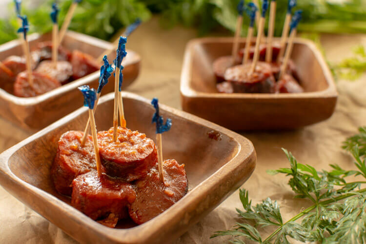 Cranberry Chili Brats with Toothpicks in Small Wooden Bowls ready for serving