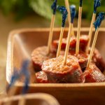 Delicious Finger Food and Cranberry Beer Brats With Toothpicks ready for serving