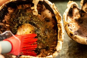 Brush Both Sides of the mushroom with an olive oil and herb mixture. The herbs add a lot of flavoring