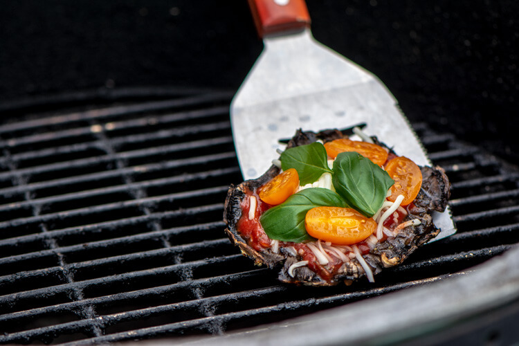 Use a Grilling spatula to remove the portobello mushroom pizza after it is fully cooked