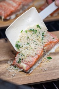 Liberally coat the salmon filet with the garlic parmesan mixture