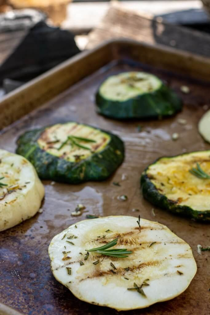 Remove the squash from the grill and set on a sheet pan to bring back into the house to serve