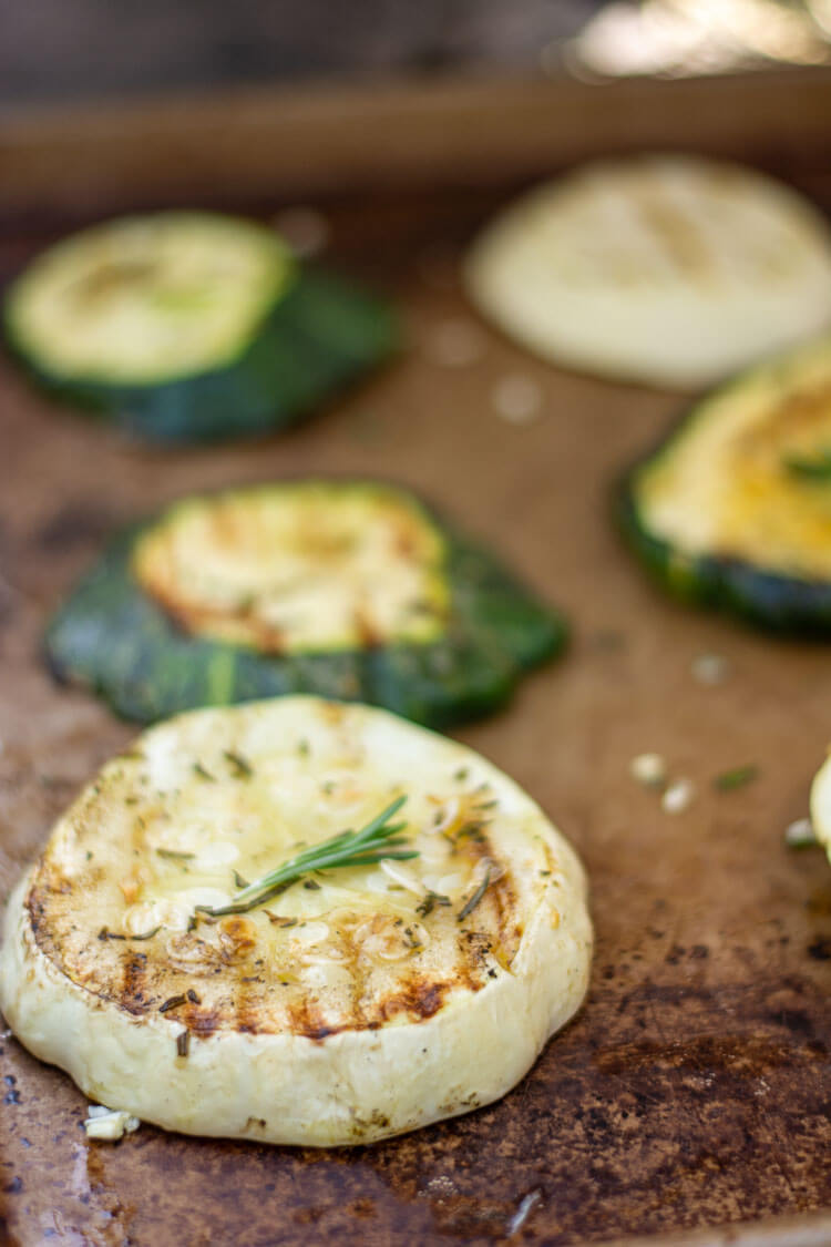 a small sprig of fresh rosemary garnishes the grilled patty pan squash