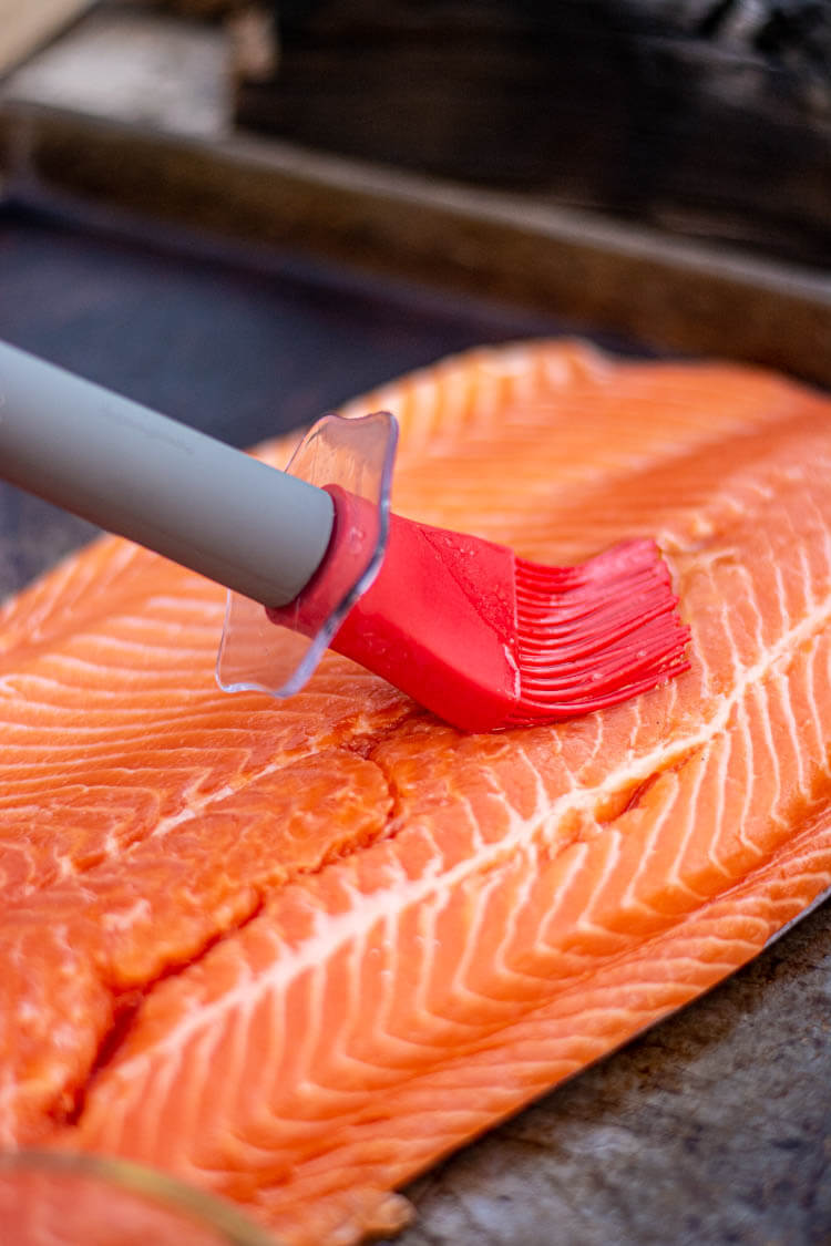 Brush the Steelhead fillet with olive oil to prevent sticking to the grill