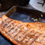 Grilled Steelhead fully cooked and resting on a sheet pan
