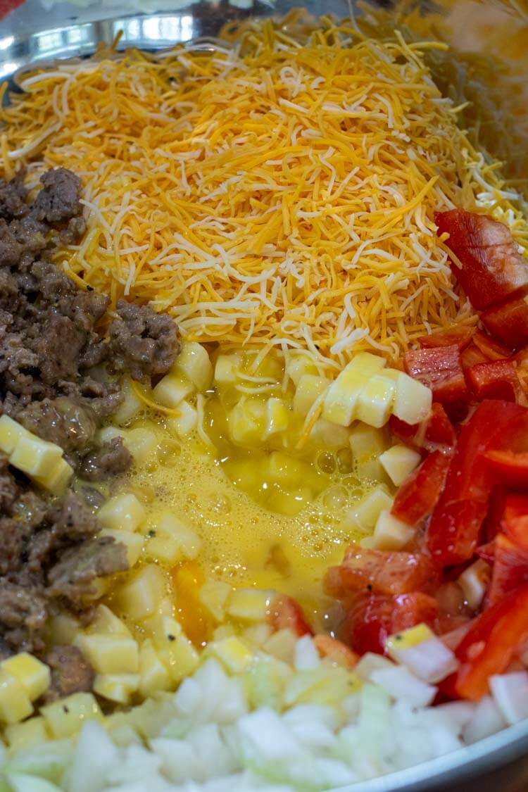 Mixing the wet and dry ingredients together for the breakfast casserole