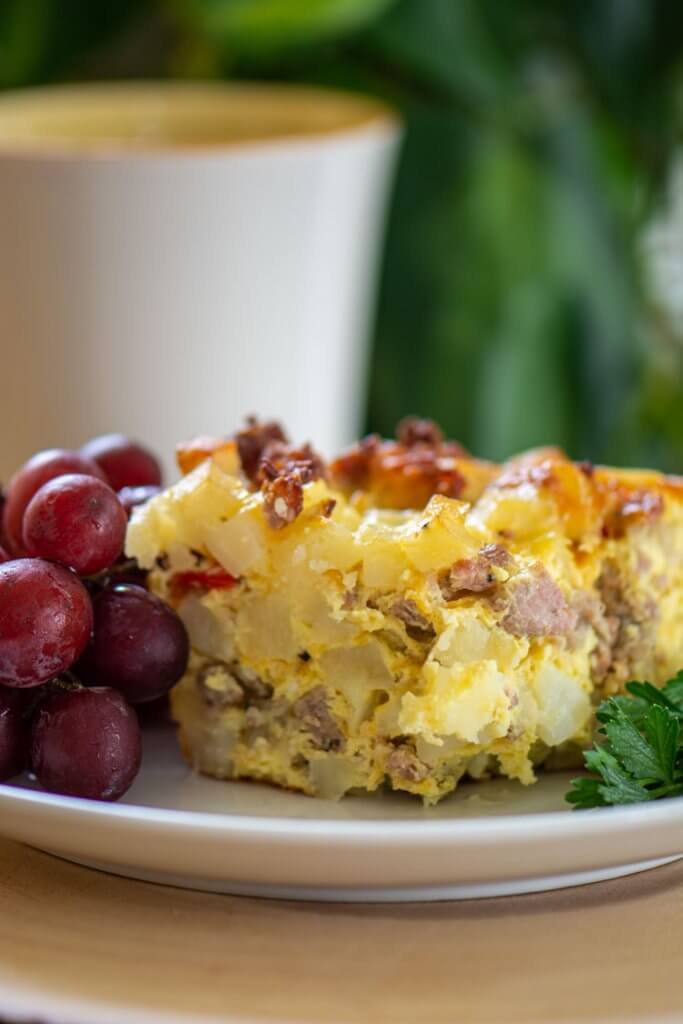 Grilled Breakfast Bake on a small plate with coffee