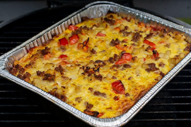 Fully cooked breakfast bake on the grill ready to be removed and served