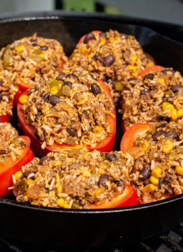 stuffed peppers in the cast iron skillet on the grill