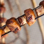marinated mushrooms with a ginger garlic teriyaki sauce on metal skewers fresh off the grill