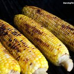Sweet and Spicy Grilled Corn with maple syrup and chili flakes